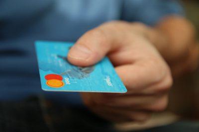 handing a credit card