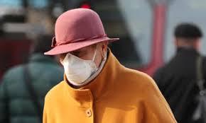elderly woman wearing a mask