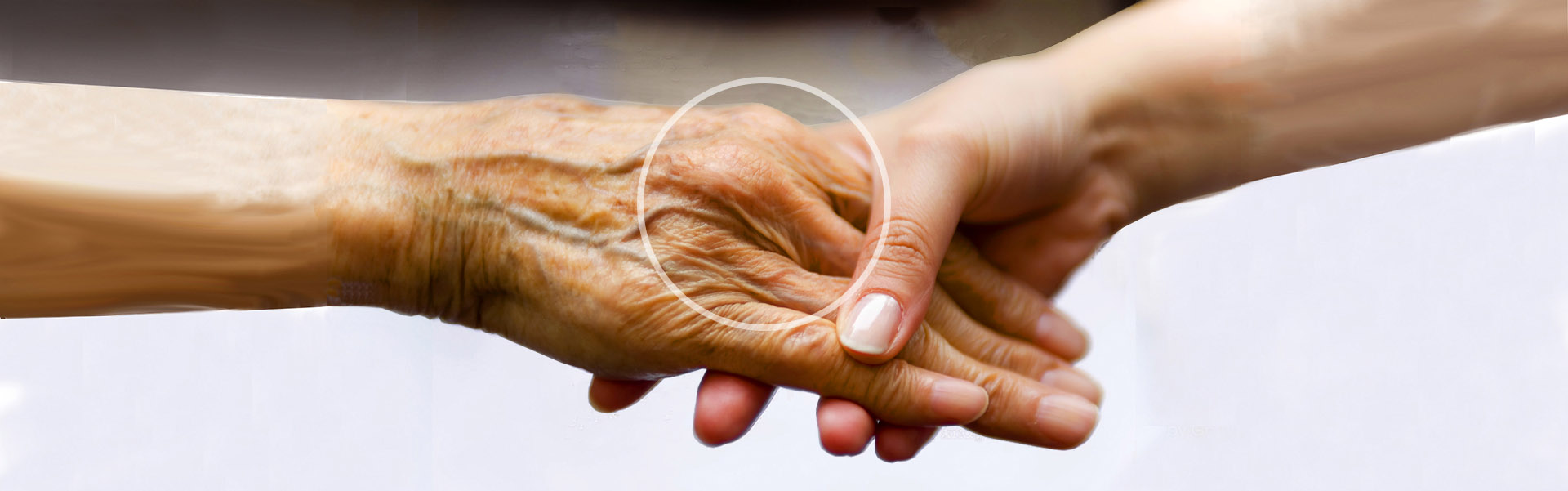 Arthritis care and treatment with young woman is holding a senior woman's hand for help.