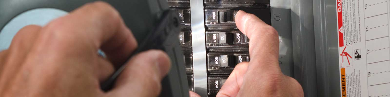 Man with Flashlight at Commercial Circuit-breaker Panel
