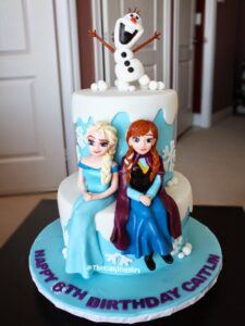 beautiful frozen elsa anna olaf figurines on cake