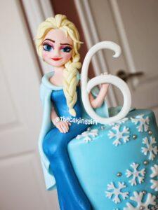 how to make edible frozen elsa figurine cake
