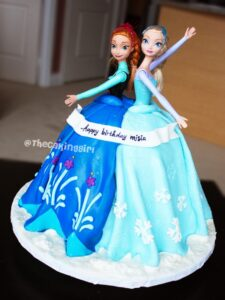 pretty elsa and anna doll cake, elsa and anna barbie dress cake