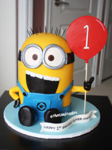 3d despicable me minion birthday cake holding balloon