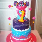abby cadabby first birthday pink purple cake