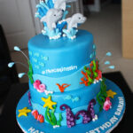 cute under water theme dolphin cake