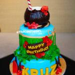 tall 3 tier Hawaiian luau birthday cake