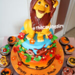lion king fondant cake with cupcakes