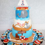 sailboat whale first birthday cake for triplets