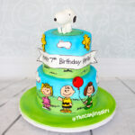 2 tier snoopy and friends birthday cake