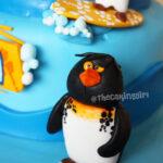 surfs up penguin cake