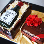 wine box and port royal cake