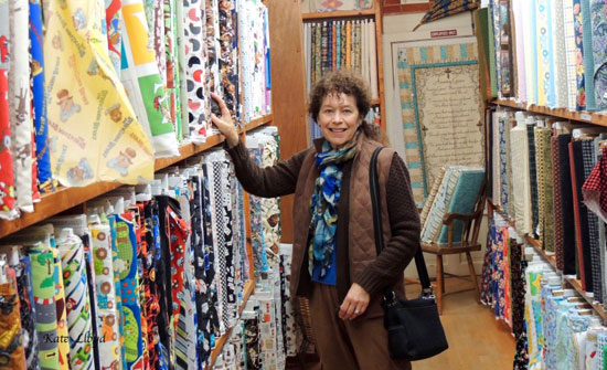 Kate Lloyd resisting the temptation to buy fancy fabric in Zook's in Lancaster County, PA.