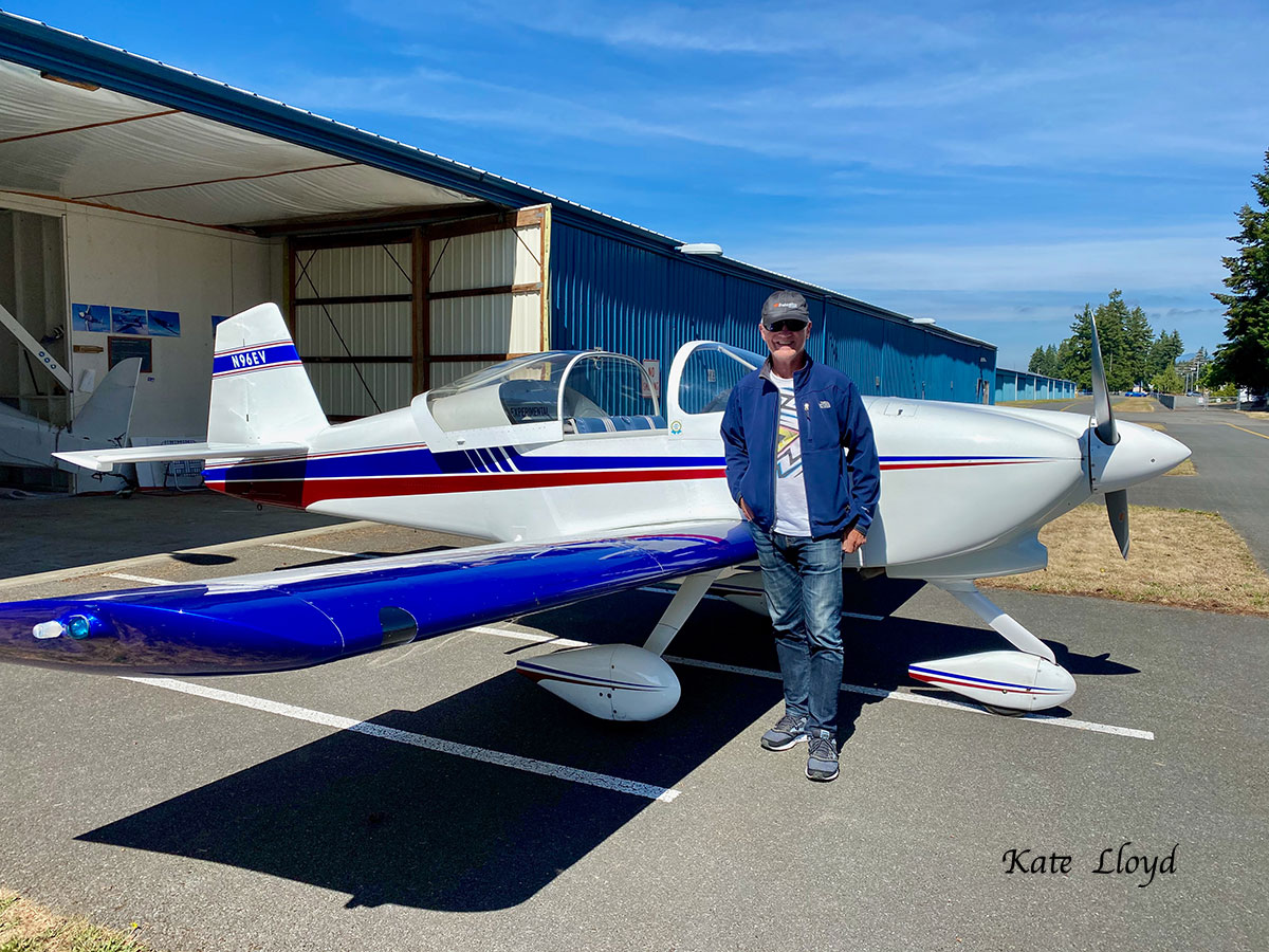 My husband, with his plane.