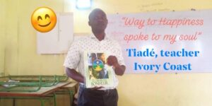 Tiade teaching his class in Ivory Coast about the Way to Happiness, Happiness and Self Improvement