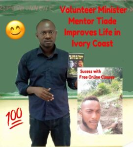 Tiade mentors a young guy picture says volunteer minister improves life in Ivory coast