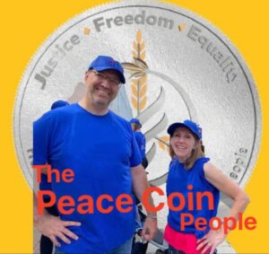 image the peace coin people, chris and kelly Watkins in front of a silver coin
