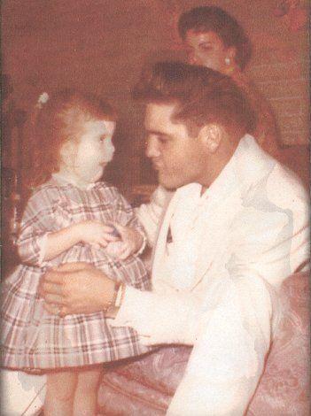 Elvis with daughter - SpotifyThrowbacks.com