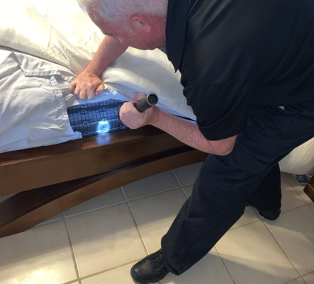 man cleaning the bed