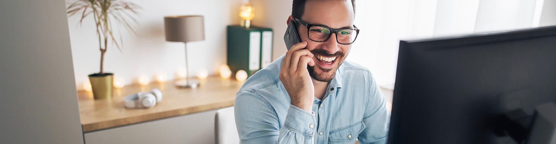 man smiling talking on phone