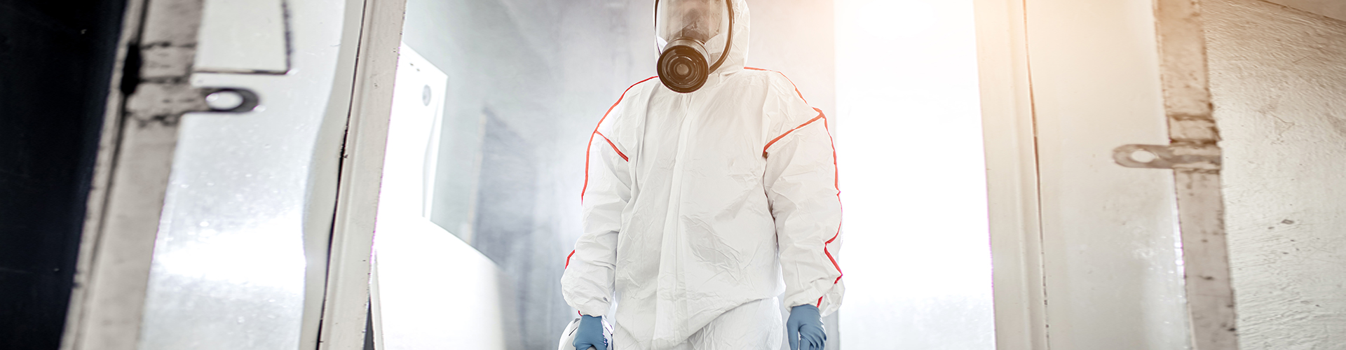 man holding pest chemical container