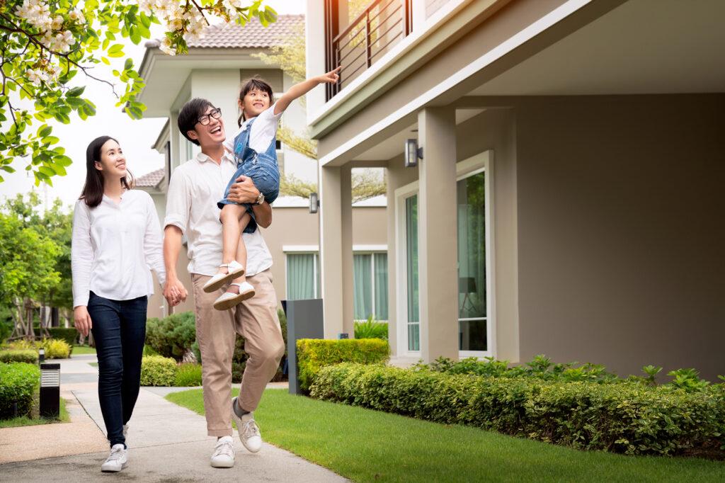Happy family walking around neighborhood