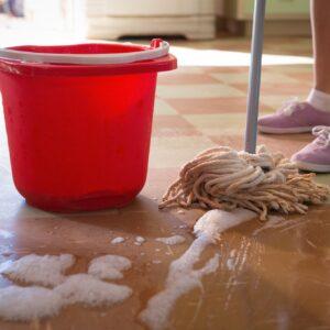 Waitress cleaning floor in restaurant