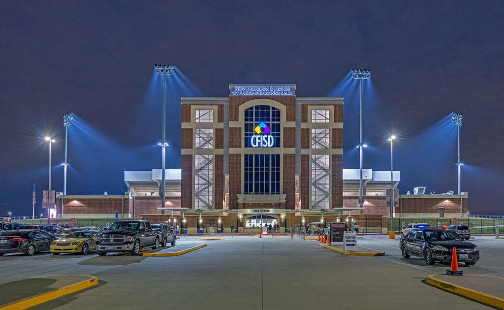 pridgeon stadium building with stadium lights and parking lot