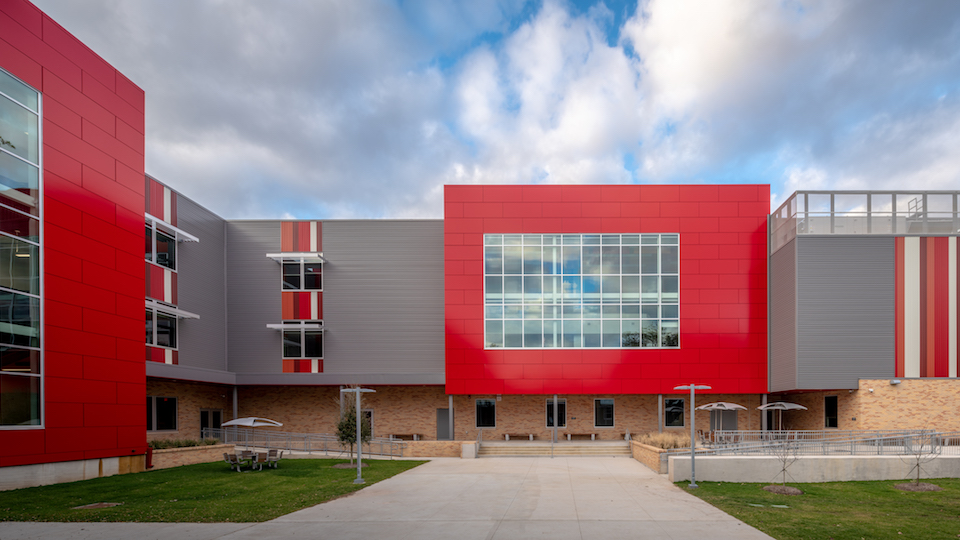 building with red and gray metal panels