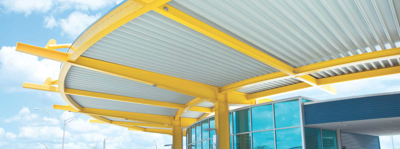 white metal canopy with yellow structural elements
