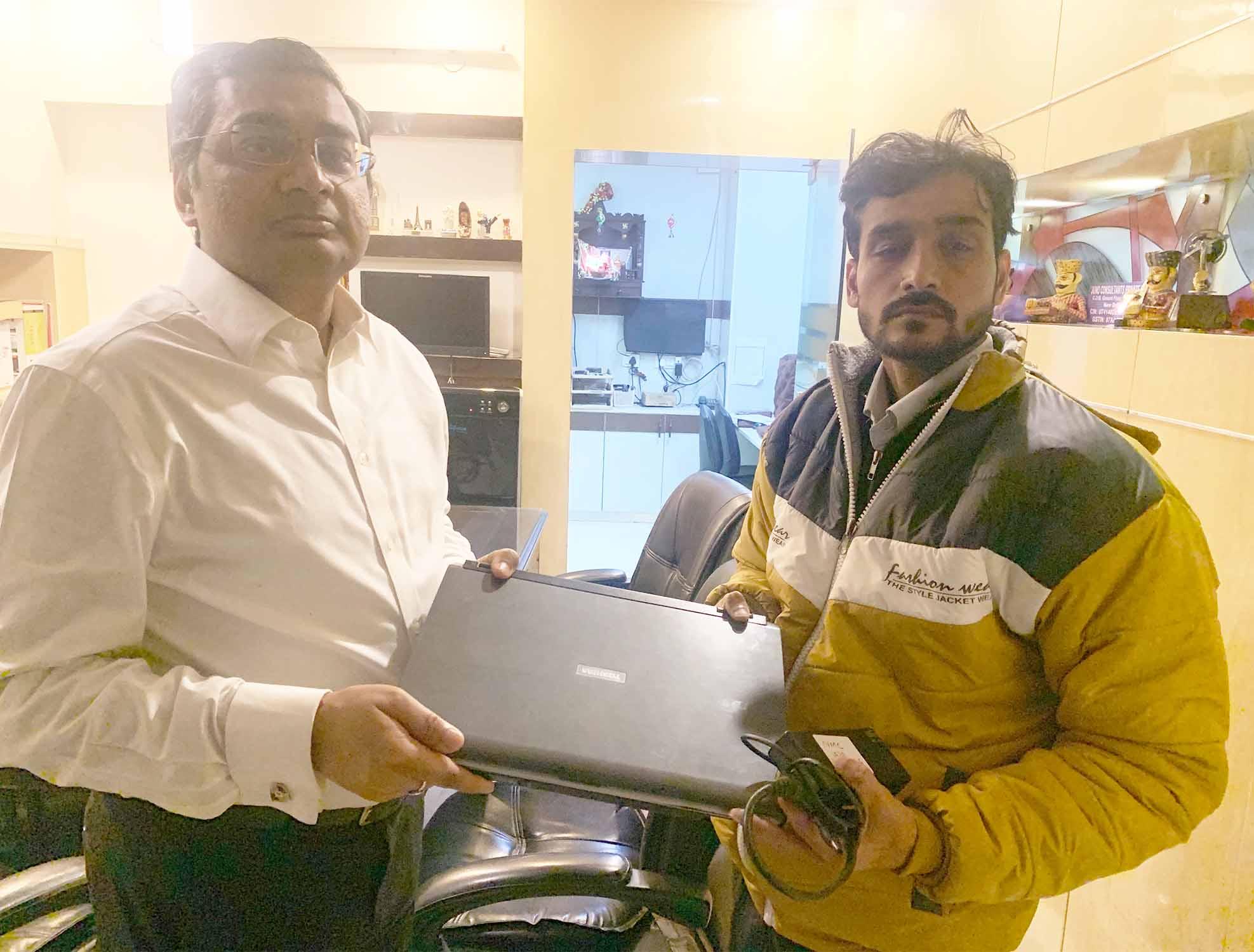 laptop distribution SKETS Hope Centre
