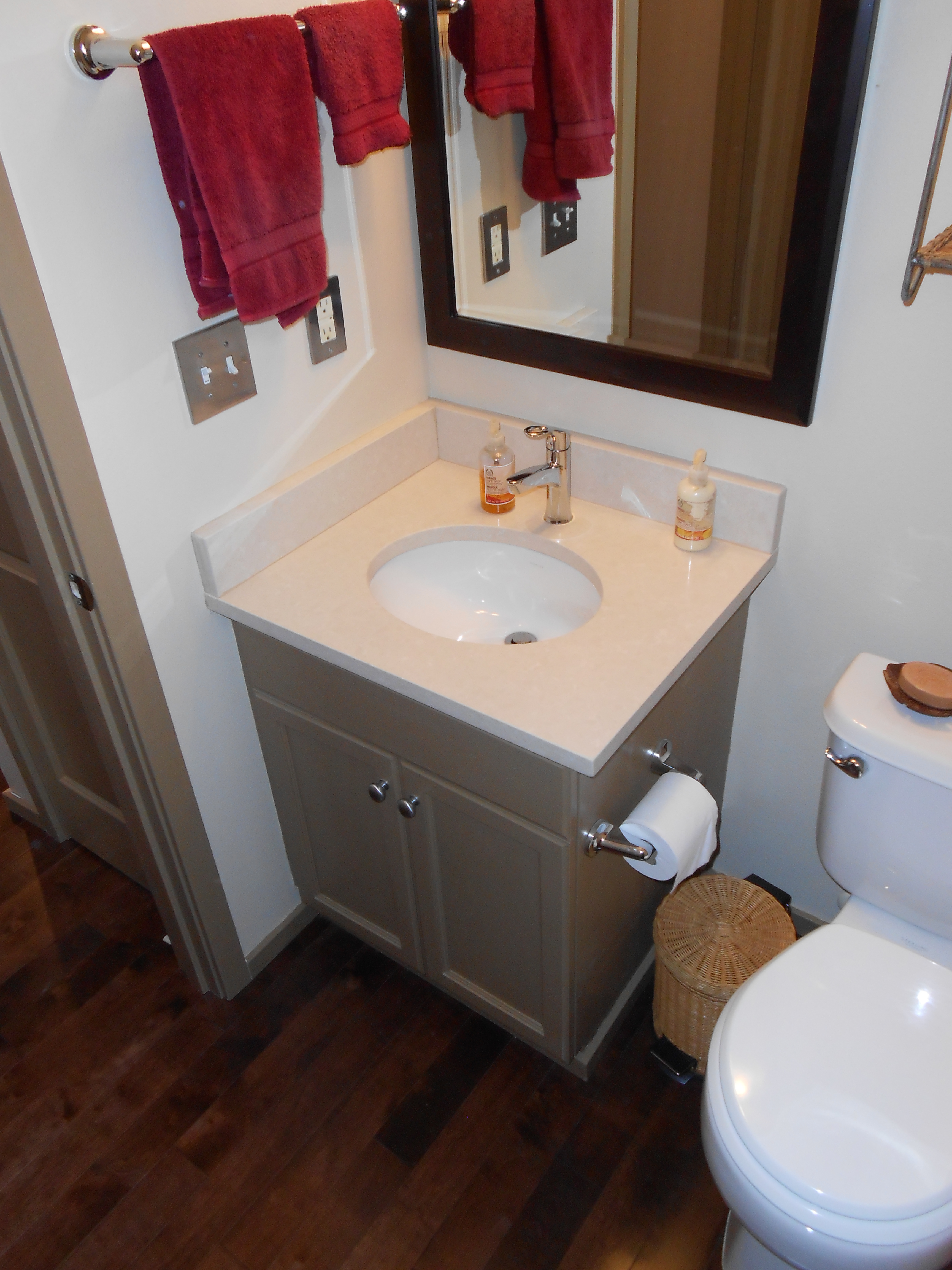 original vanity and with new quartz top in powder room