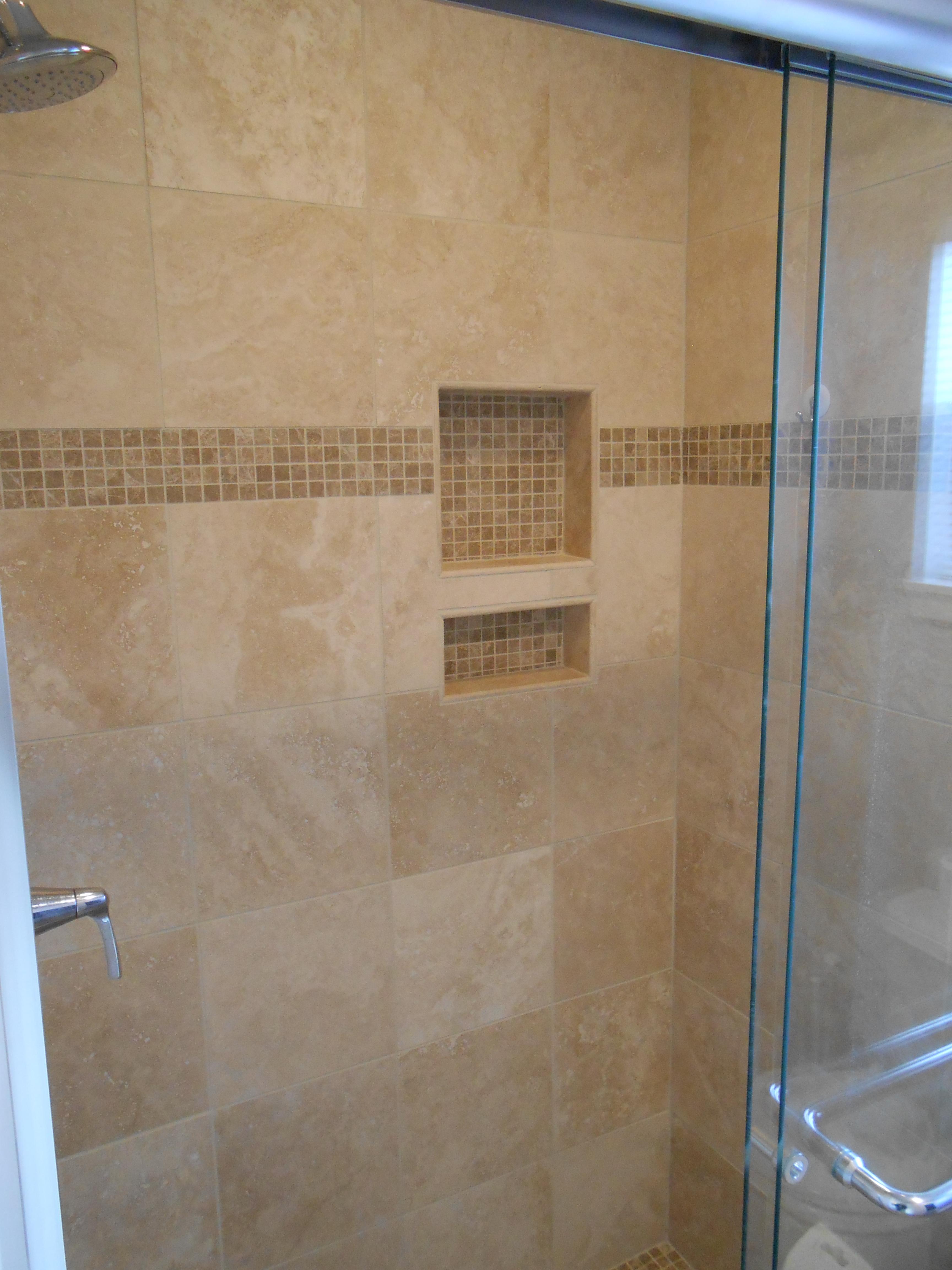 shower niche with travertine accent tiles