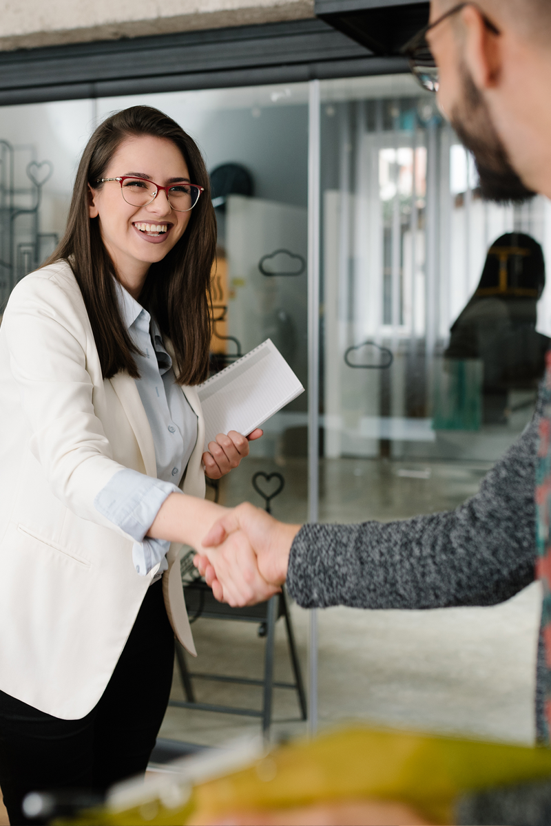 Country Club HR recruiter shaking hands with job candidate