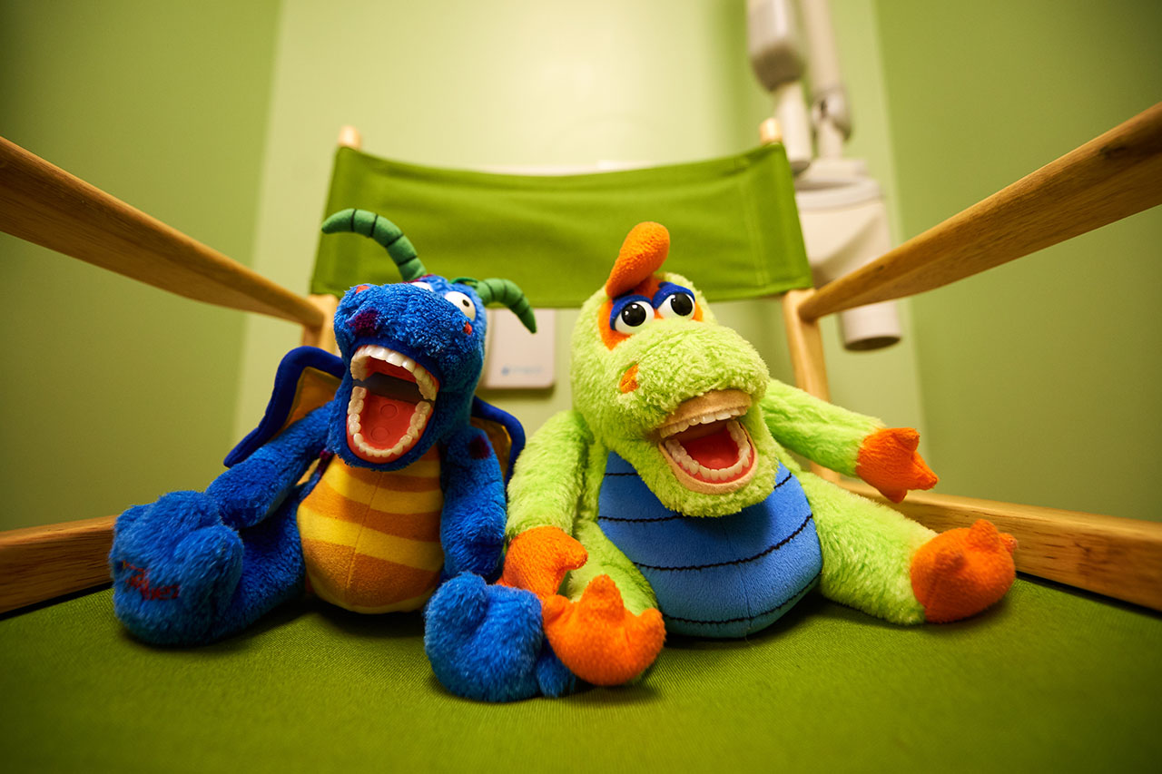 Two Stuffed Animals with Fake Teeth