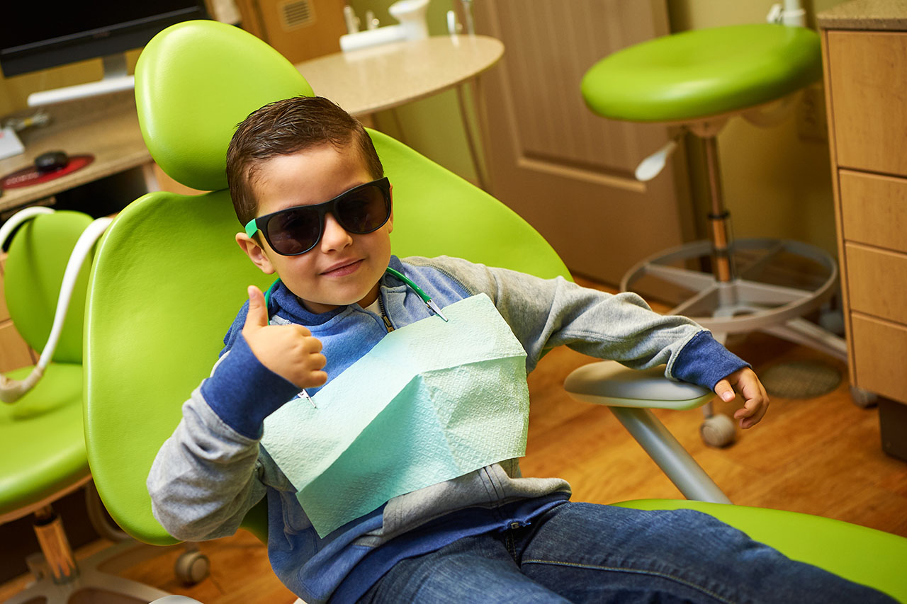 Child Giving Thumbs Up After Dentist Visit
