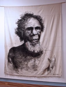 Malian Ipai (Wogal People) Materials: Charcoal on drop sheet Measurements: 235cm x 285cm (Please note to Aboriginal and Torres Strait Islander people this portrait is of a deceased Aboriginal person). *This is definitely the largest charcoal drawing I have created so far and I am very proud of this piece. It has been a total honor. *Permission to draw this portrait was given by Michael Robinson (Pender Thomas Mason) a direct descendant of Murray Jack (Malian Ipai).