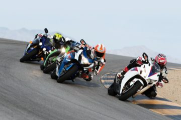 racing motorcycles in curve