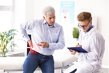 nephrology doctor attending his patient