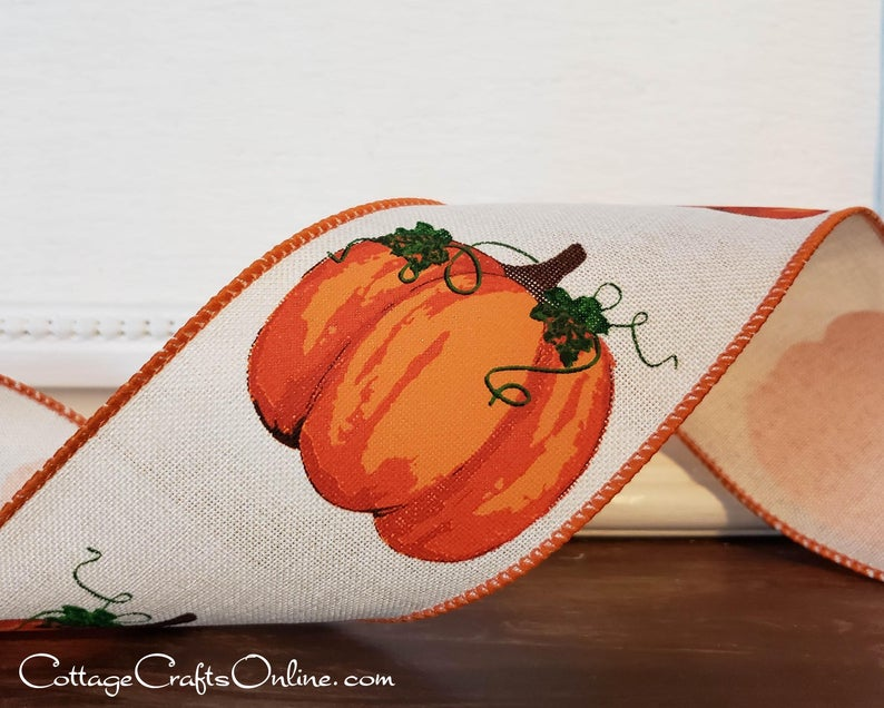 A fall-themed ribbon with pumpkin patterns intricately stitched on