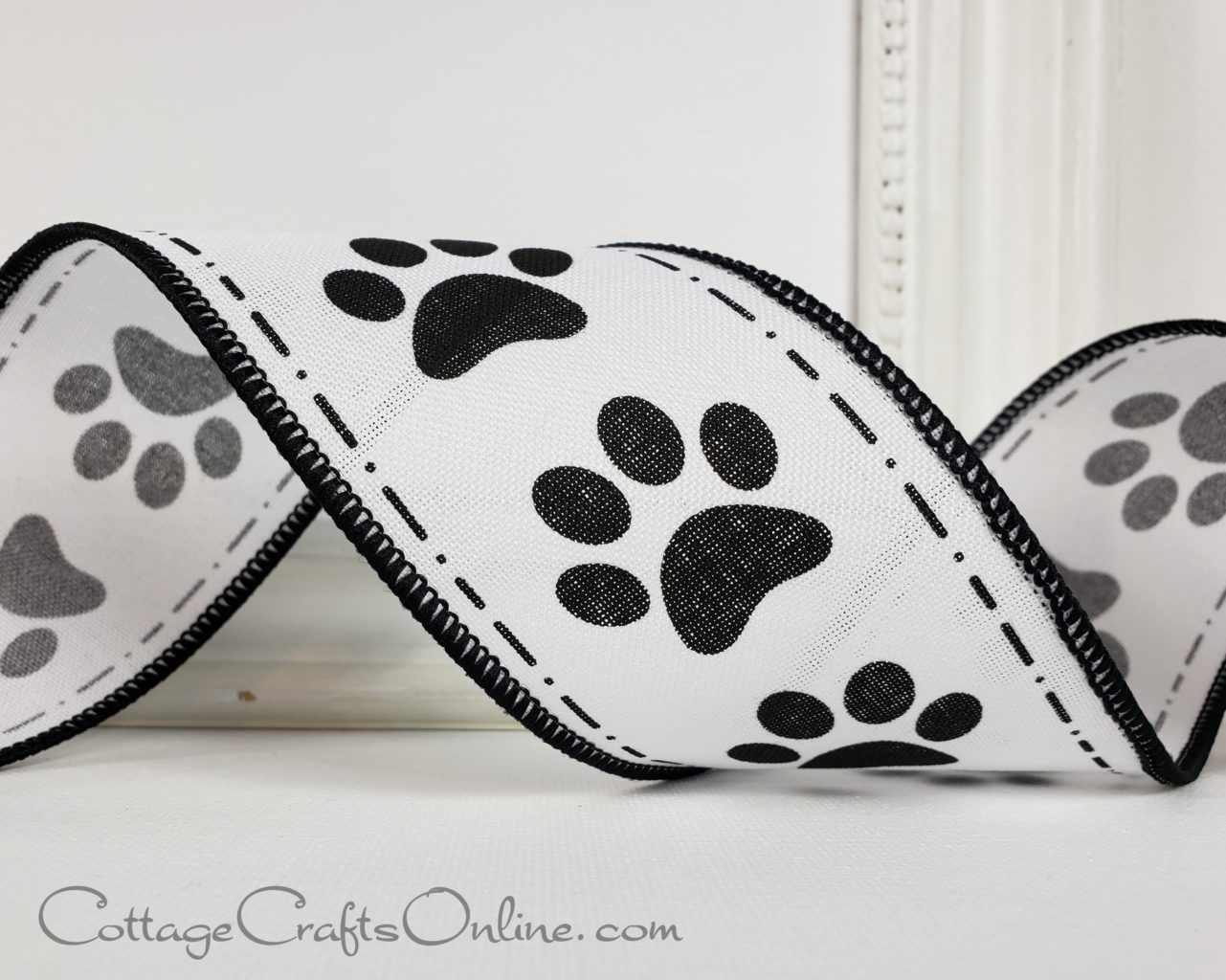 A black and white ribbon with pawprint patterns