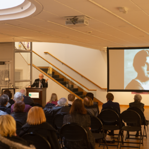 A room of attendees listening to a JCC Cultural Arts lecture.