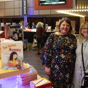 Two women smiling and posing for a camera at a shopping event for the Detroit Jewish Book Fair in 2019.