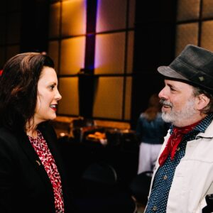 Governor Gretchen Whitmer speaking with a patron at the Lenore Marwil Detroit Jewish Film Festival
