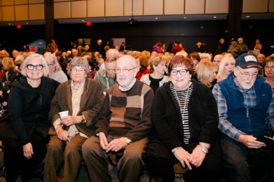 A look at a crowded auditorium of smiling SAJE attendees.
