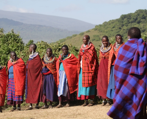 a group of Maasai in very colorful clothing in the Ngorongoro Conservation Area