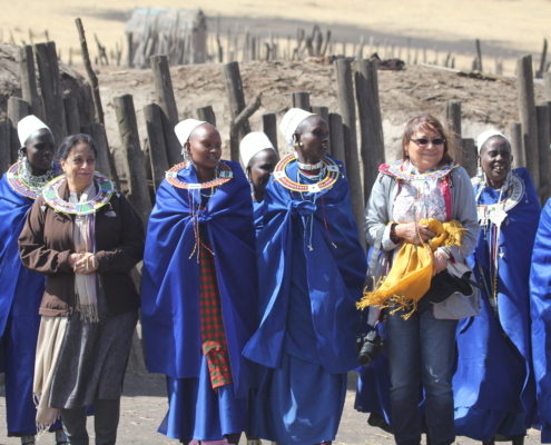 a group of Maasai women with guests in the Ngorongoro Conservation area