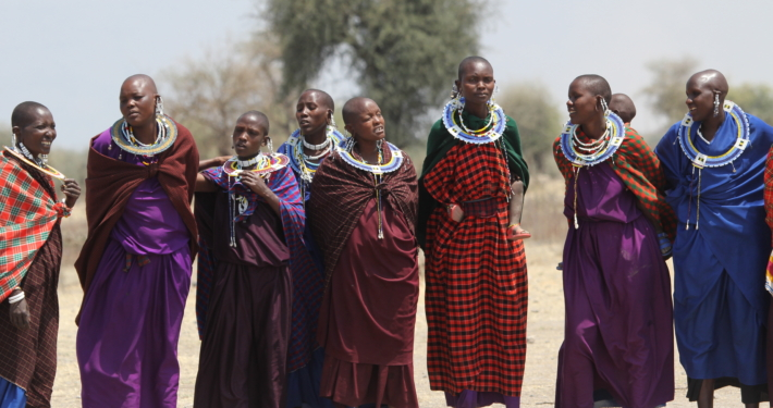 a group of Maasai women in very colorful clothing in the Ngorongoro Conservation area