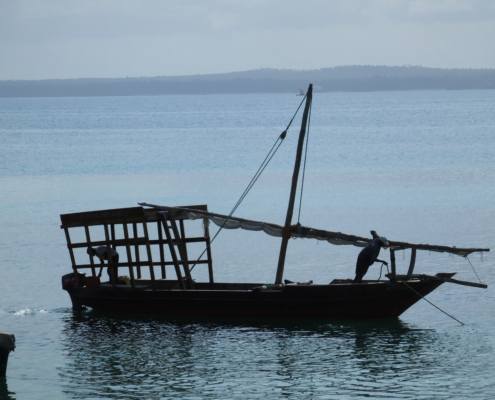 small wooden fishing boat on the ocean near Zanzibar