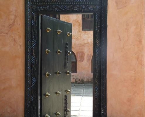 intricately carved wooden door in Stone Town (Zanzibar)